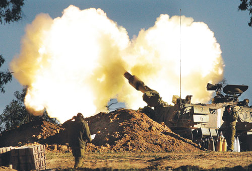 Jan 6, 2009.  A mobile artillery gun fires from the Israeli side of the border toward targets in the southern Gaza Strip.